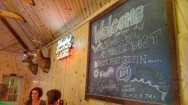 The finely drawn welcome sign in the bar at George's Highlander Bar and Grill.