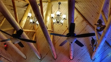 The exposed beams and mounted animals in the bar area at George's Highlander Bar and Grill add to the hunting lodge aesthetic.