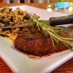 The Jim Bourbon Steak with a side of wild rice.