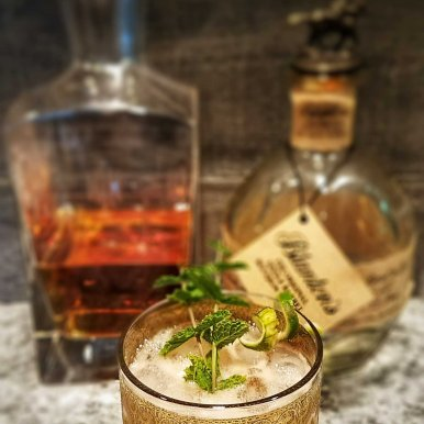 The finished cocktail featuring Blanton's and Tippleman's Double Spiced Falernum syrup. Delicious!