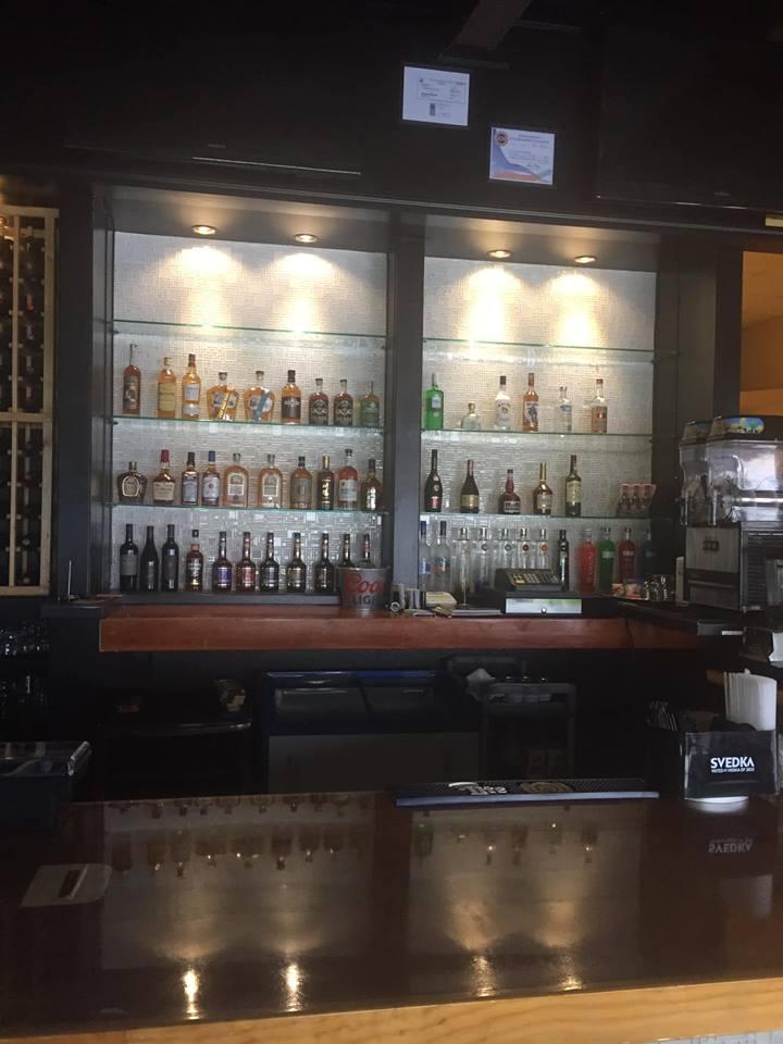 Asian-Cajun displaying their liquor selection.